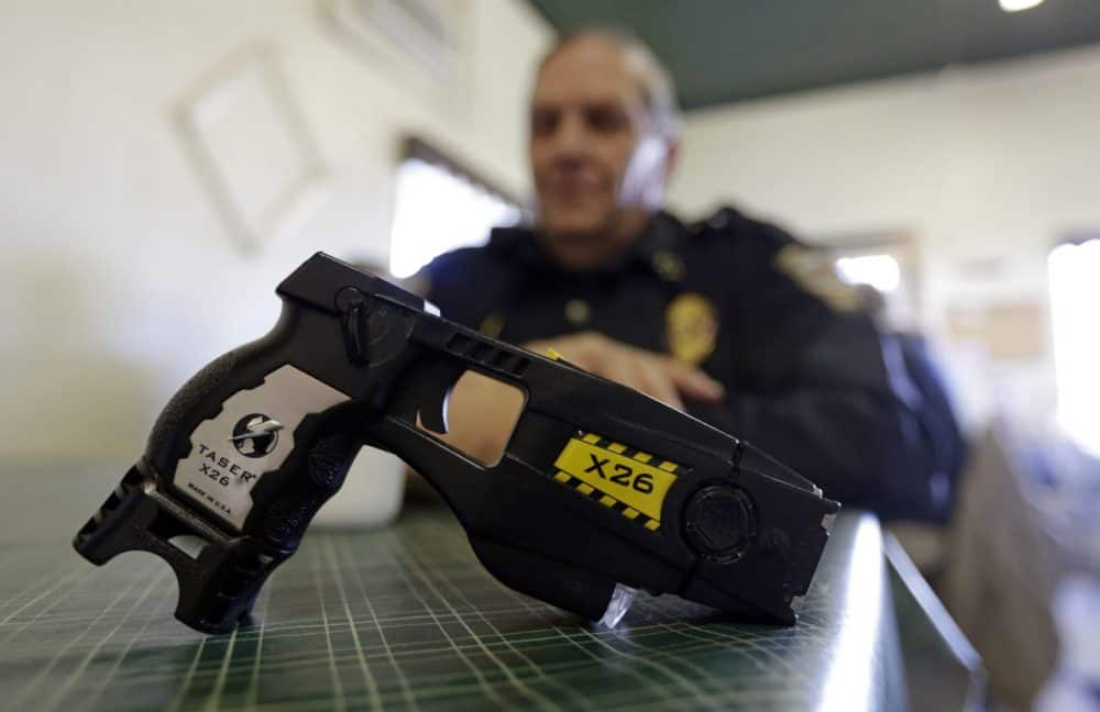 how many volts are in a police grade taser